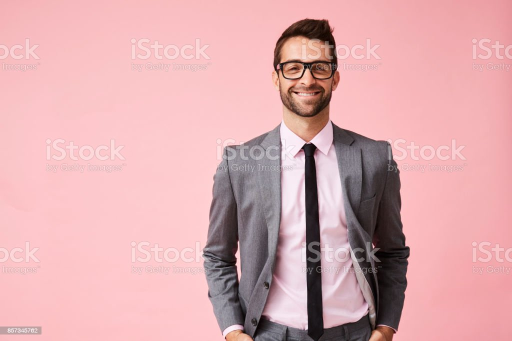 Happy grey suit guy Happy grey suit guy in pink studio, portrait 30-34 Years Stock Photo