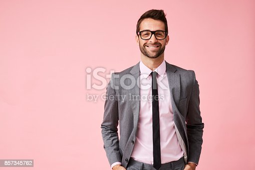 istock Happy grey suit guy 857345762