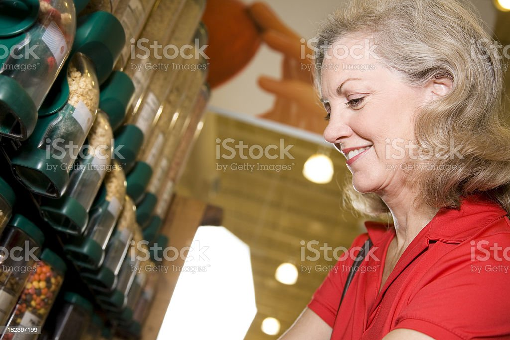 Happy Grocery Shopper Buying Cereal at the Supermarket Store royalty-free stock photo