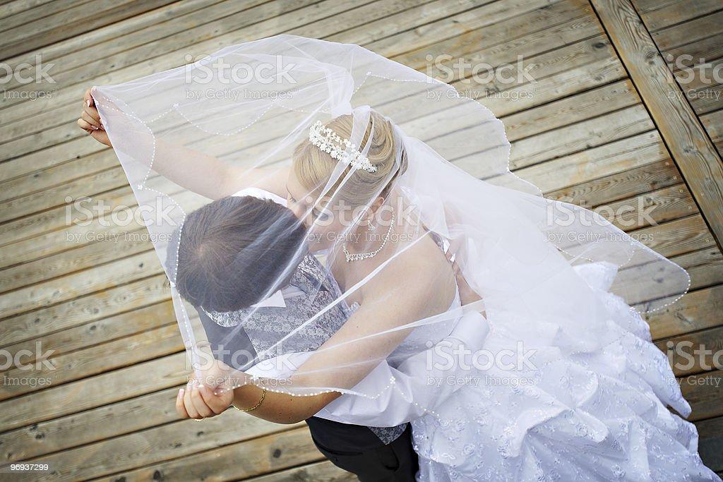 Happy groom and bride on wedding walk royalty-free stock photo