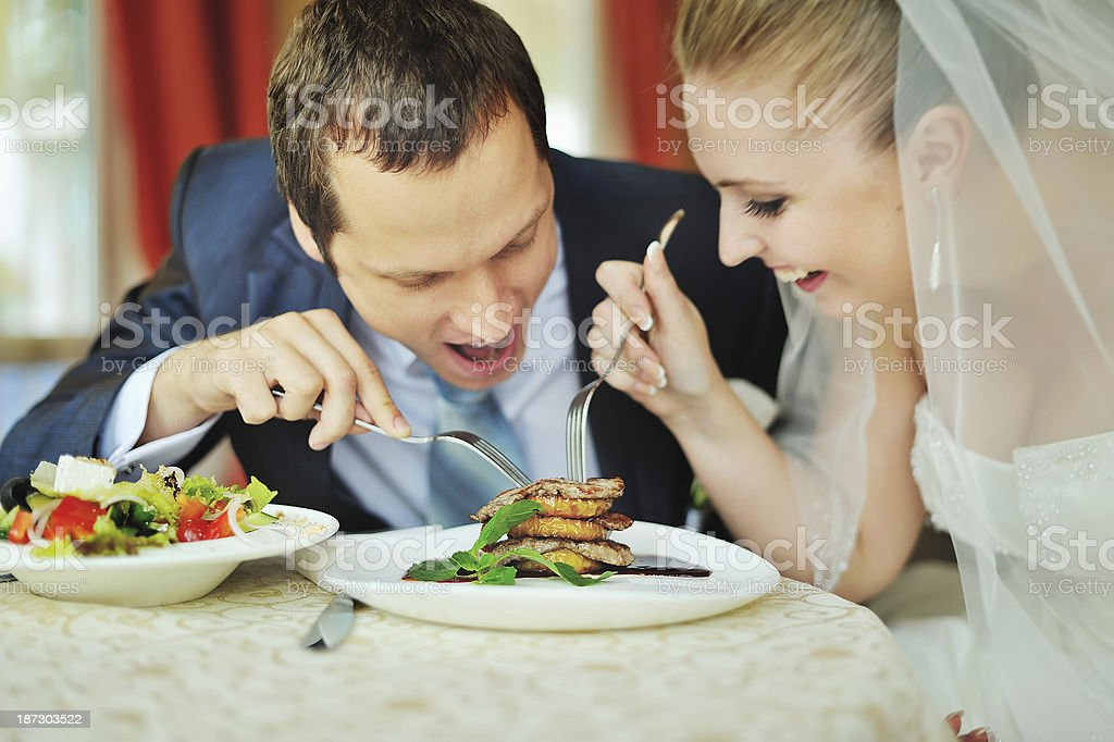 happy groom and bride  together in cafe stock photo