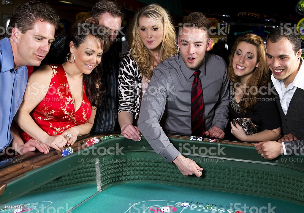 Happy Group of Adults Gambling at Craps Table royalty-free stock photo