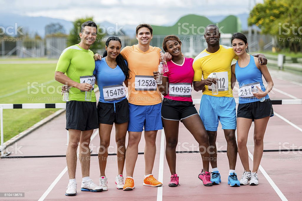Happy group of athletes stock photo