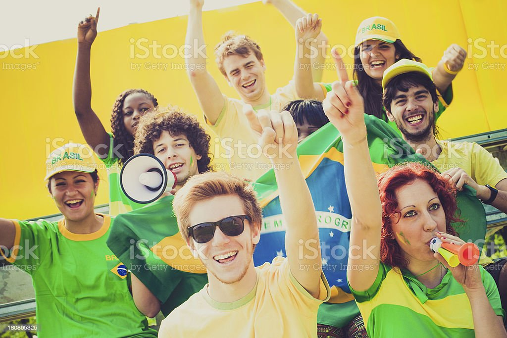 Happy Group of Brasilian Footbal Team Supporters Cheering royalty-free stock photo
