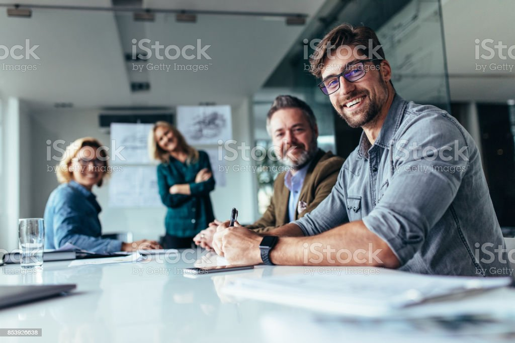 Happy group of businesspeople during presentation stock photo