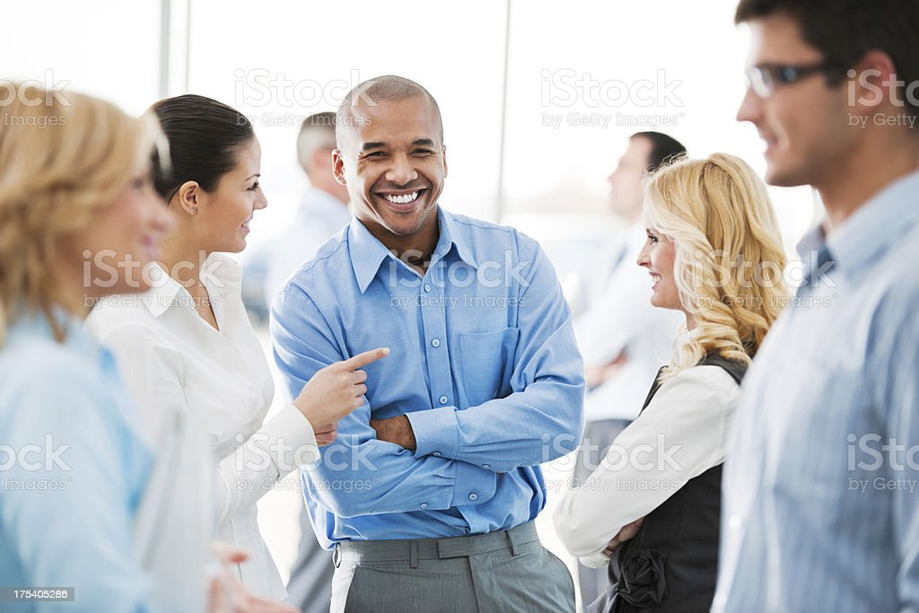 Happy group of businesspeople laughing stock photo