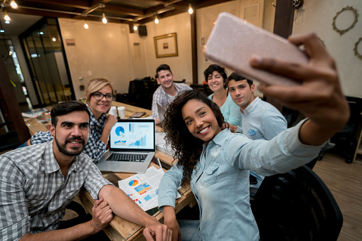 Happy Group Of Coworkers Taking A Selfie At A Creative Office Stock Photo - Download Image Now