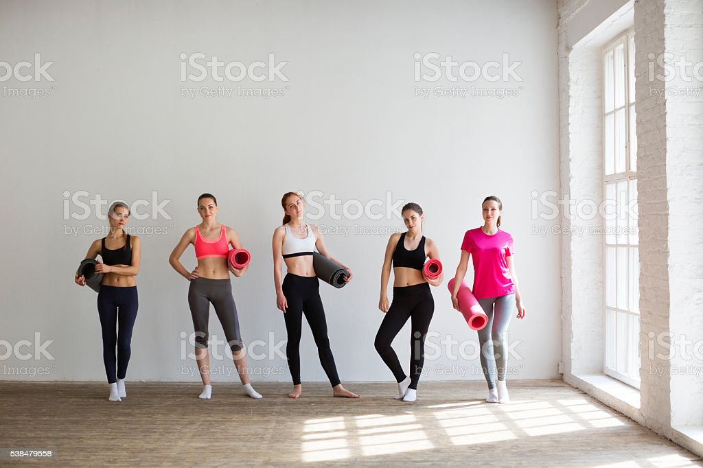 Happy group of fit women at the gym. stock photo