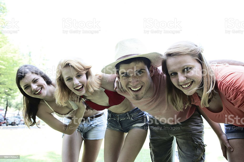 Happy group of four friends royalty-free stock photo
