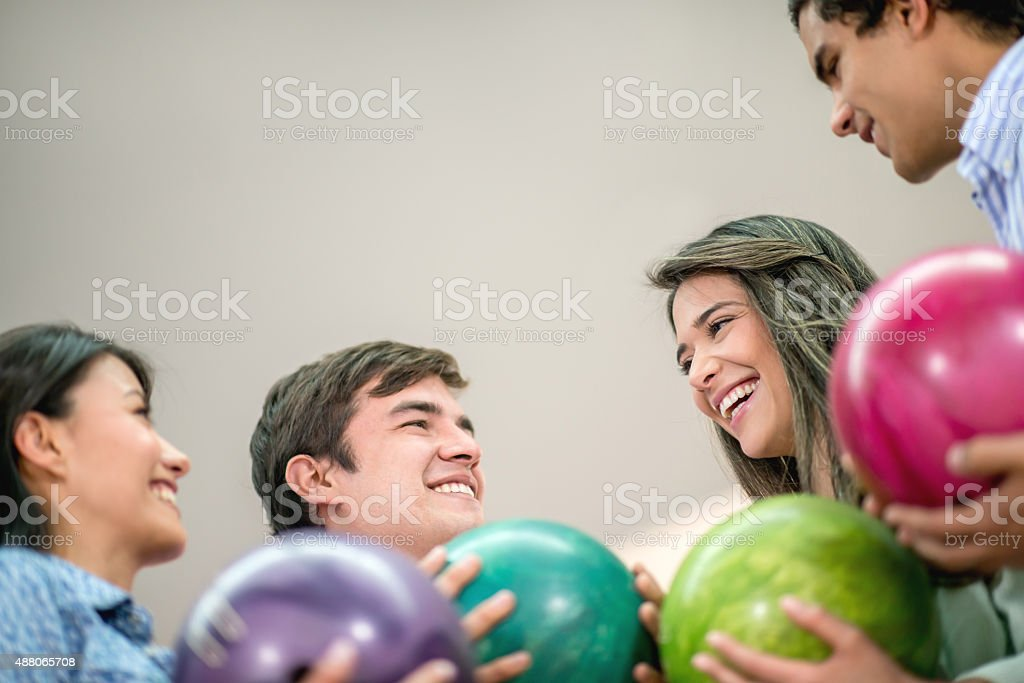 Happy group of friends bowling stock photo
