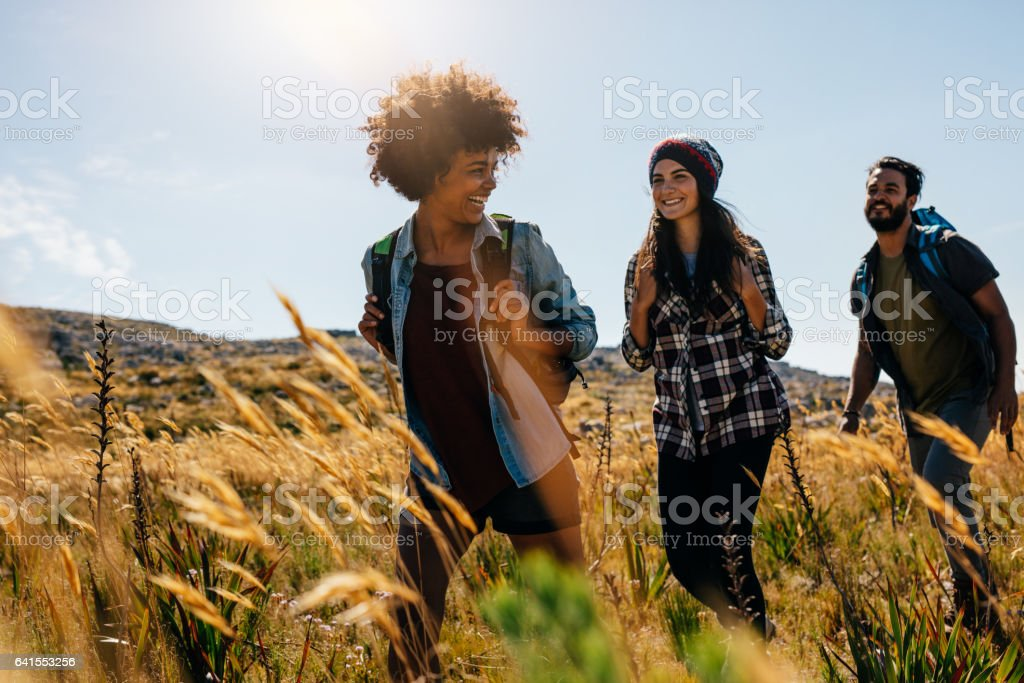 Happy group of friends hiking together stock photo