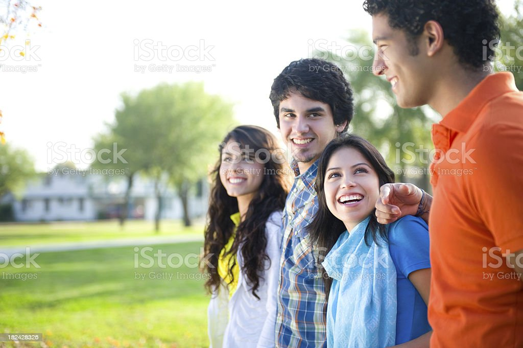 Happy group of latin friends royalty-free stock photo