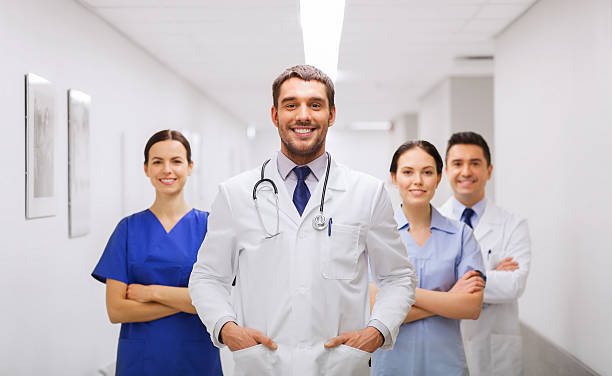 happy group of medics or doctors at hospital stock photo