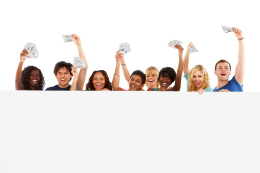 Happy group of multiracial students holding cash behind blank billboard on white background