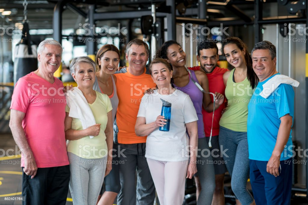 Happy group of people at the gym stock photo