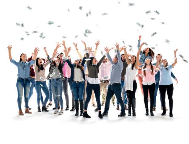 glückliche gruppe von menschen, die geld in die luft schnappen - lotto stock-fotos und bilder