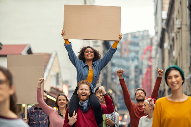 Happy group of people holding blank banner during strike stock photo