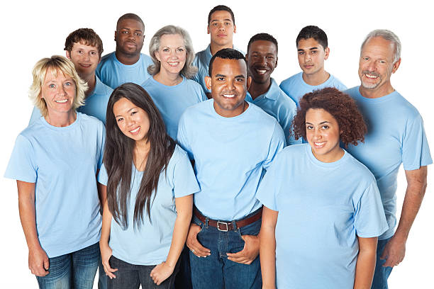 Happy group of people in blue shirts stock photo