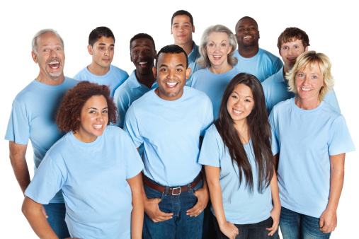 Happy group of people laughing together, all in blue shirts