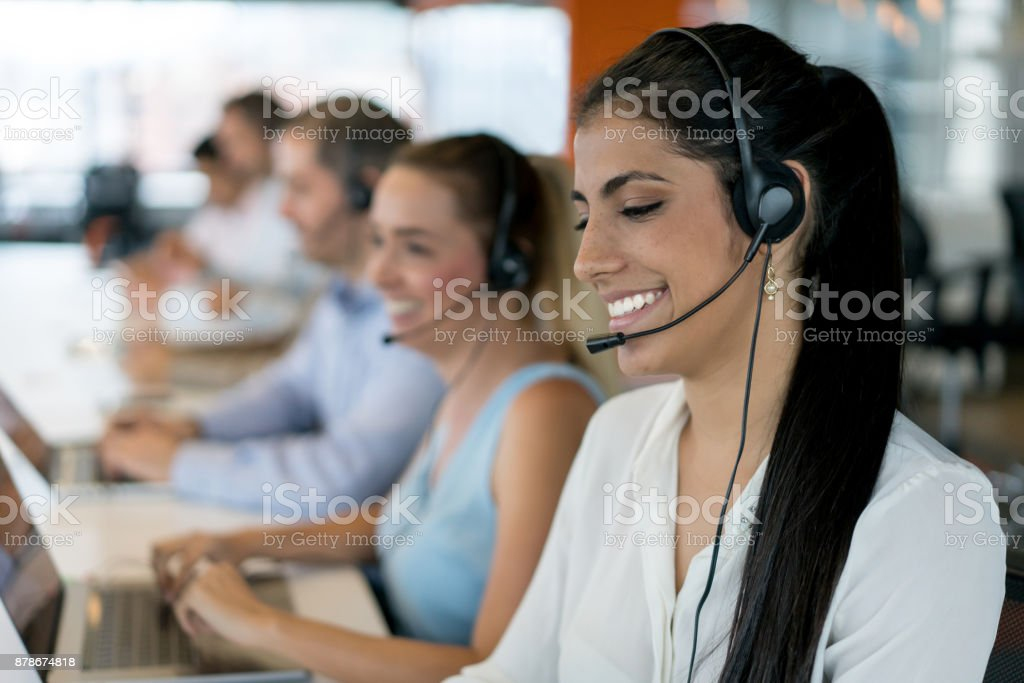 Happy group of people working at a call center stock photo