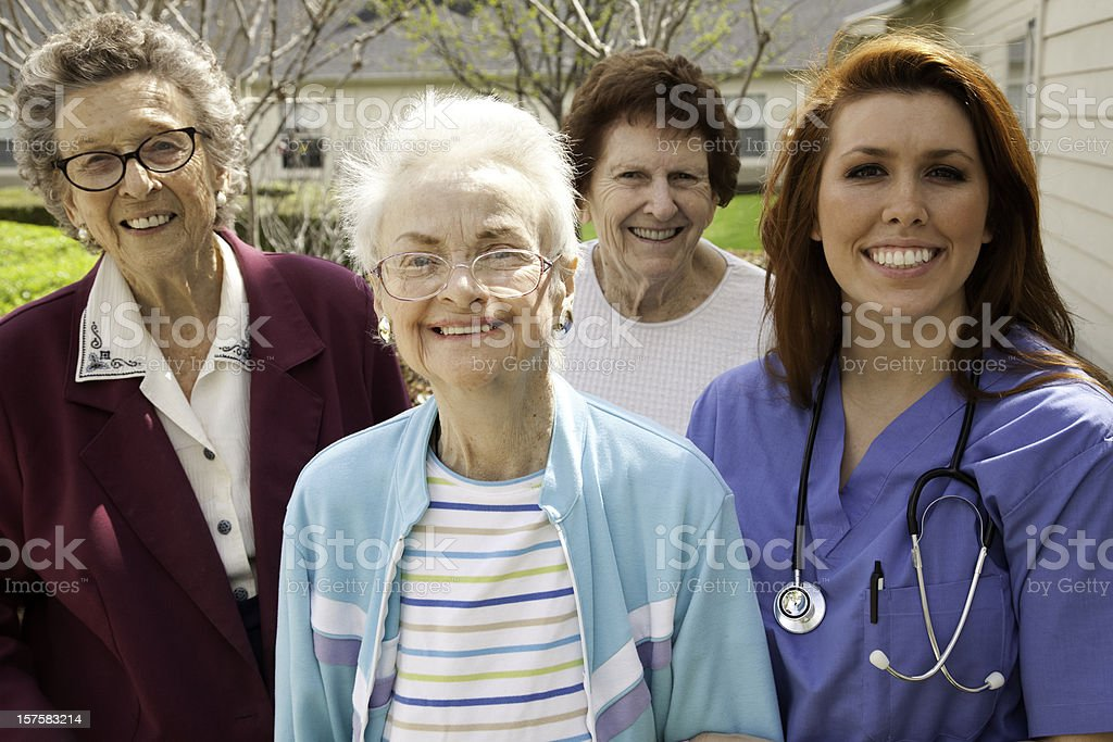 Happy Group of Senior Adults with Healthcare Worker royalty-free stock photo