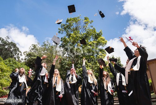 istock Happy group of students celebrating their graduation 1049624106