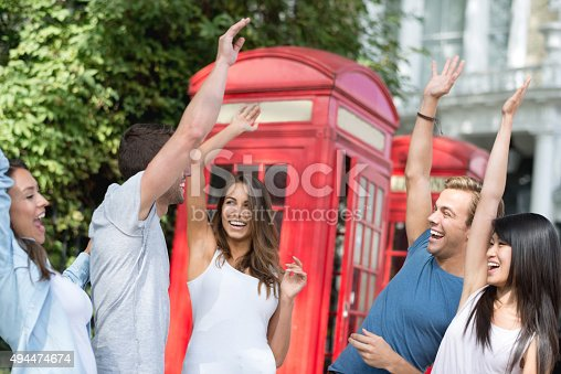 istock Happy group of students giving a high-five 494474674