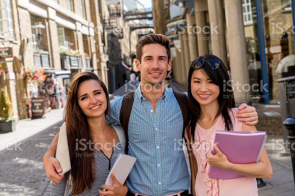 Happy group of students Portrait of a happy group of students in London looking at the camera smiling 20-29 Years Stock Photo