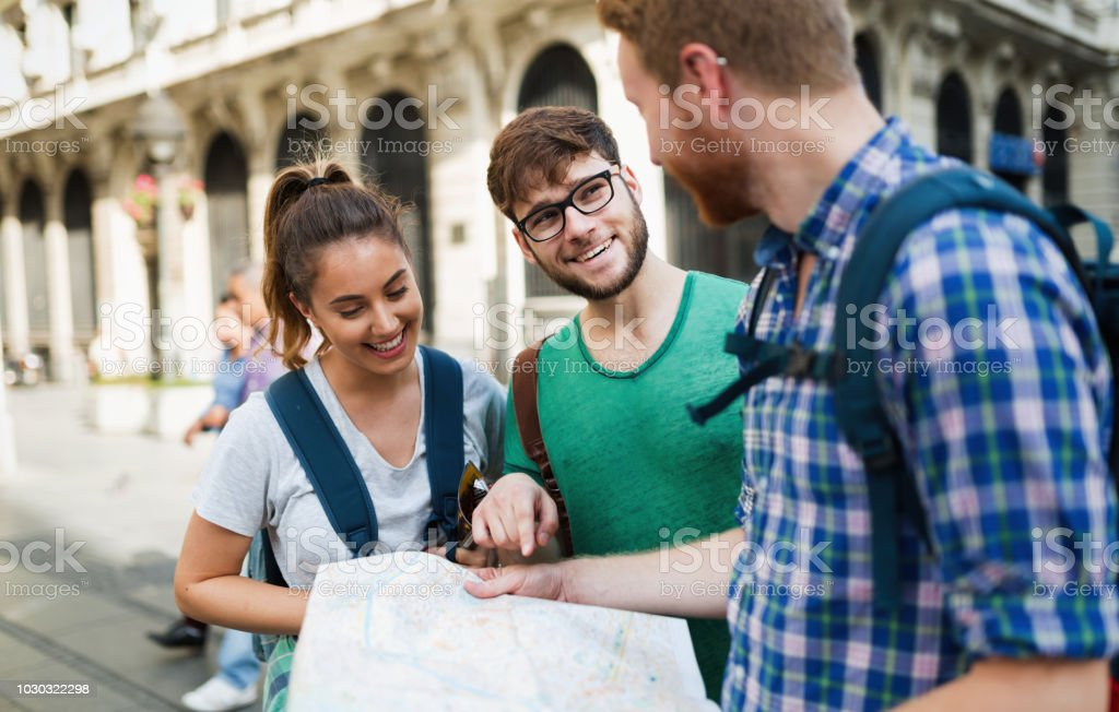 Happy group of tourists traveling and sightseeing stock photo
