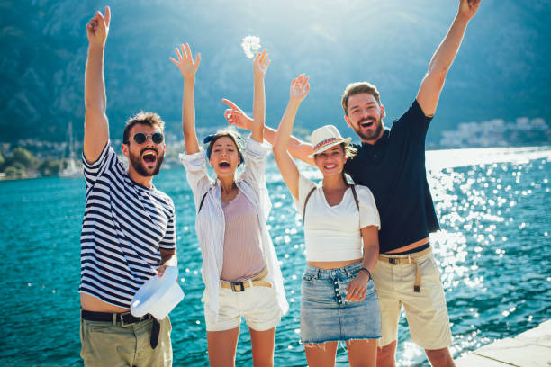 Happy group of tourists traveling and sightseeing together stock photo