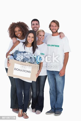 istock Happy group of volunteers holding donation box 851587726