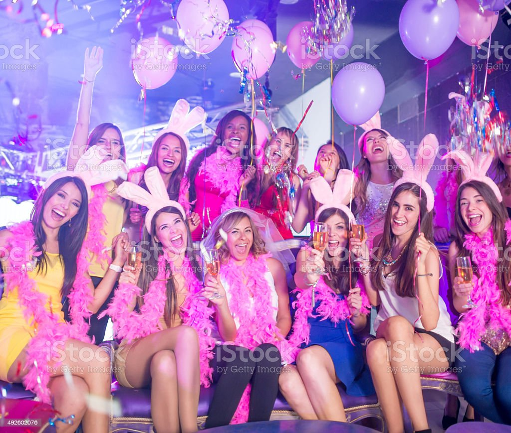 Happy group of women at a bachelorette party stock photo