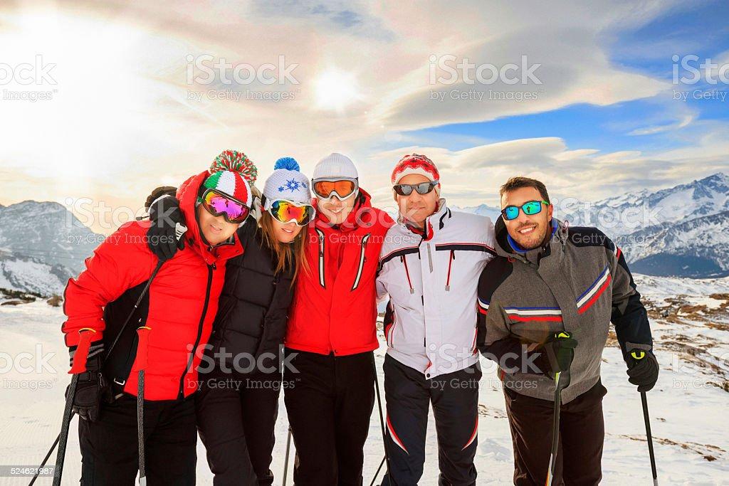 Happy group skiers, best friends, Madonna di Campiglio ski resort stock photo