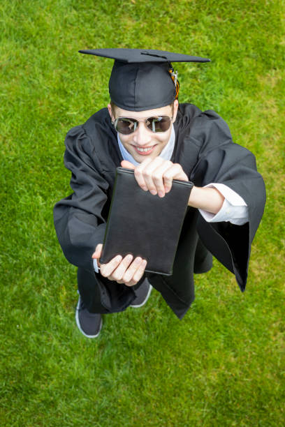 happy guy graduate - sdominick stock pictures, royalty-free photos & images