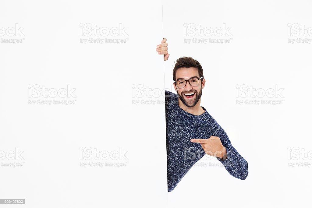 Happy guy points stock photo