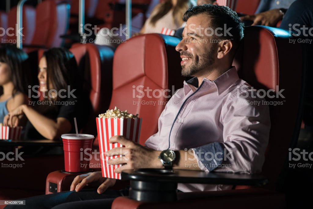 Happy guy watching a movie stock photo