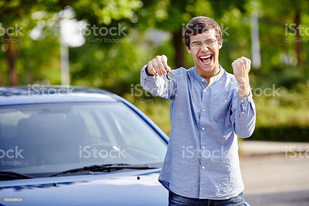 Happy guy with car keys stock photo