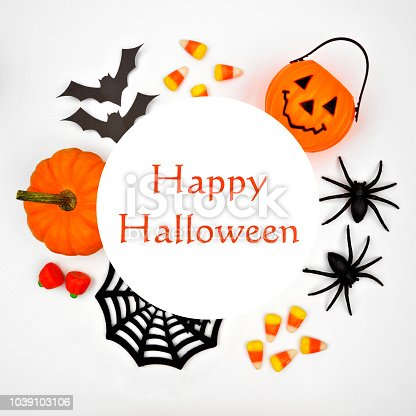 1057069236 istock photo Happy Halloween greeting on a white background with circle frame of decor 1039103106