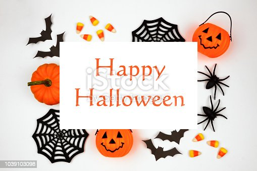 1057069236 istock photo Happy Halloween greeting on a white background with frame of decor 1039103098