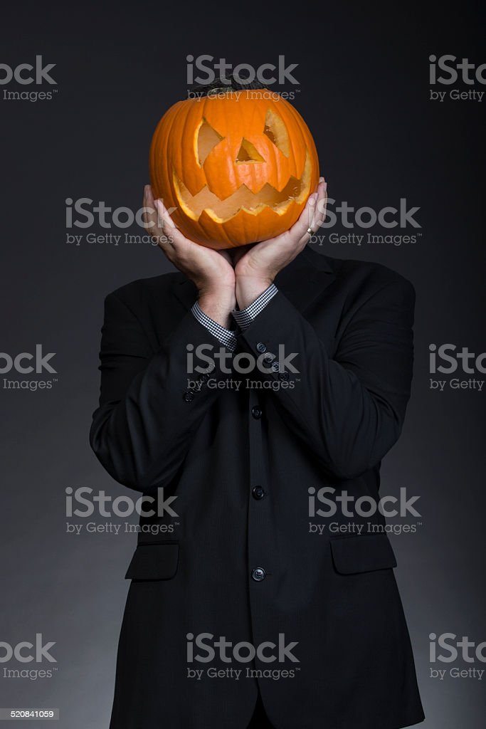 Halloween Maan.Happy Halloween Man Holding His Head In Studio Stock Photo