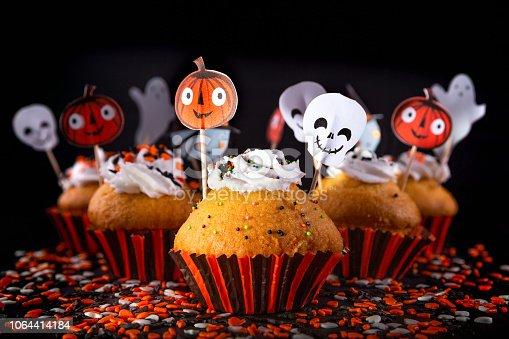 istock Happy Halloween muffin cupcakes 1064414184