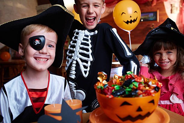 Happy Halloween Cheerful children celebrating Halloween costume eye patch stock pictures, royalty-free photos & images