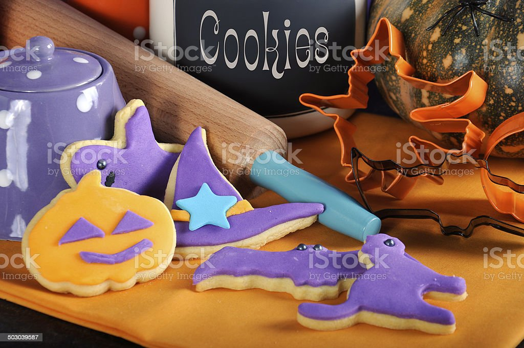 Happy Halloween purple and orange cookies with rolling pin closeup. royalty-free stock photo