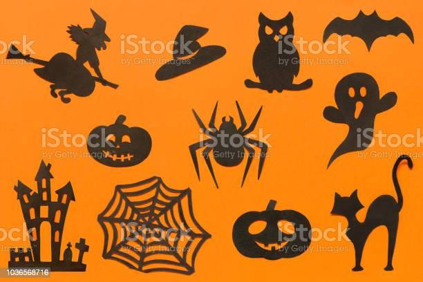 Happy halloween set silhouettes cut out of black paper on orange picture id1036568716?b=1&k=6&m=1036568716&s=612x612&h=b5xmh6a9iyf 8wpdtye9cmceued98lizfmm8z0ujlcc=
