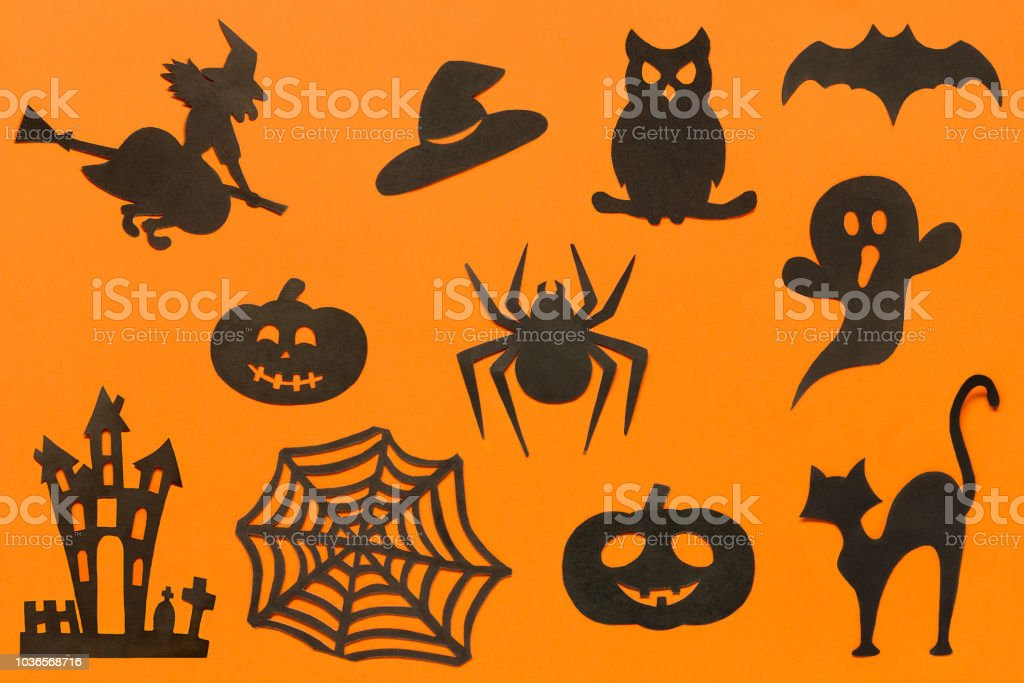 Happy Halloween Set silhouettes cut out of black paper on orange background. stock photo