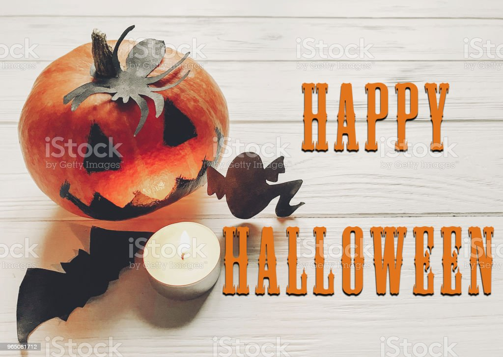 happy halloween text. jack lantern pumpkin with witch ghost bats and spider black decorations on white wooden background. simple cutouts for autumn holiday celebration. seasonal greetings zbiór zdjęć royalty-free