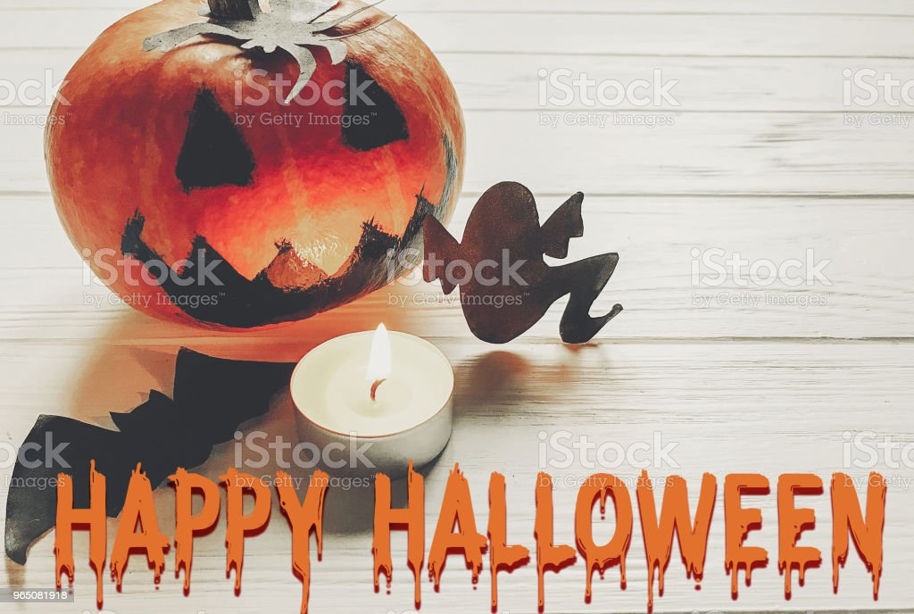 happy halloween text. jack lantern pumpkin with witch ghost bats and spider black decorations on white wooden background top view. seasonal greetings, holiday celebration zbiór zdjęć royalty-free