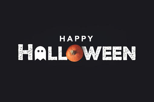 istock Happy Halloween Text With Pumpkin and Ghost Over Black Background 1169816120