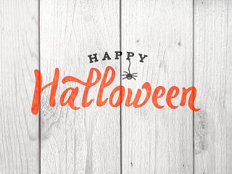 istock Happy Halloween Typography Over Wood 846586914