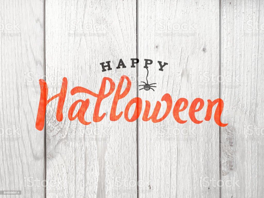 Feliz Halloween tipografía sobre madera - foto de stock